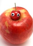 Sweet cherry & big red apple. Sweet cherry with eyes on a red apple stock photos