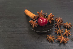 Sweet cherry on black table with cinnamon and star anise. Sweet Red cherry on black table royalty free stock photos
