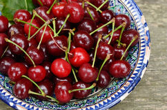 Sweet cherry in blue oriental bowl Stock Photos