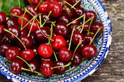 Sweet cherry in blue oriental bowl Royalty Free Stock Images