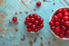 Sweet Cherry in Bowl on Rustic Table Royalty Free Stock Photos