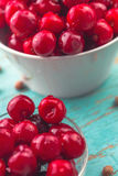 Sweet Cherry in Bowl on Rustic Table Royalty Free Stock Photography