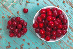 Sweet Cherry in Bowl on Rustic Table Stock Image