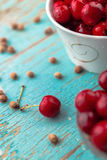 Sweet Cherry in Bowl on Rustic Table Royalty Free Stock Photo