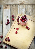 Sweet cherry in a bowl on wooden table Stock Image
