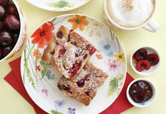 Sweet cherry cake, cherry jam, cappuccino and fresh cherries. Top view. Homemade cherry tart, cappuccino and fresh cherries Stock Photos