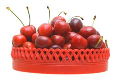 Sweet cherry fruits. Sweet cherry fruits in a red plate on a white background Stock Images