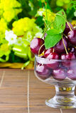 Sweet cherry fruits in glass goblet Stock Photos