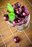 Sweet cherry fruits in glass goblet Royalty Free Stock Photos