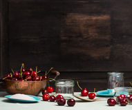 Sweet cherry jam and  jelly preserve preparing on rustic wooden background, place for text Royalty Free Stock Photography