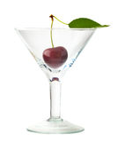 Sweet cherry with leaf in glass Royalty Free Stock Photos