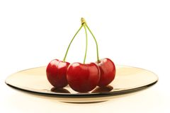Sweet cherry on plate Stock Photos