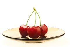 Sweet cherry on plate Stock Photos