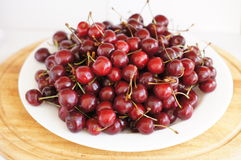 Sweet cherry on a plate Stock Photos