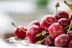 Sweet cherry on a silver plate Royalty Free Stock Photo