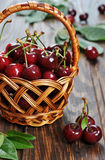 Sweet cherry. Some beautiful sweet cherry in a basket  on a wooden background Royalty Free Stock Photography