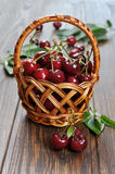Sweet cherry. Some beautiful sweet cherry in a basket on wooden background Stock Images