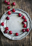 Sweet cherry on vintage plate. Royalty Free Stock Images