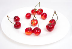 Sweet cherry on white plate. Isolated Stock Photo