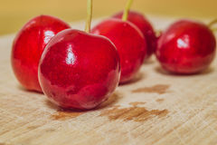 Sweet cherry on a wooden surface Stock Image