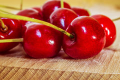 Sweet cherry on a wooden surface Stock Photos