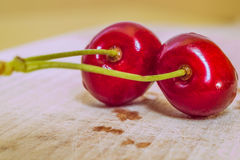 Sweet cherry on a wooden surface Stock Images