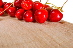 Sweet cherry on a wooden surface Royalty Free Stock Images