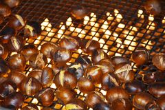 Sweet chestnuts and flames, background Royalty Free Stock Photography