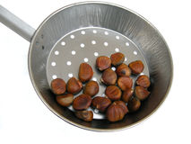 Sweet chestnuts in pan Stock Photo