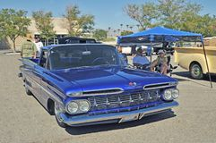 Sweet 1959 Chevy El Camino. This style of El Camino with the large tail fins is rarely seen these days. The suspension has been lowered and the car painted with Stock Photos