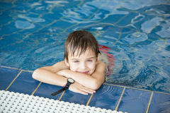 Sweet child, boy, playing in water world playground, enjoying at. Tractions, swimming in a big swimming pool on a holiday stock photos