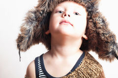 Sweet child in a fur hat. fashion funny kid. winter style. little boy. children Royalty Free Stock Photography