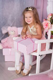 Sweet child girl with pink gift box Stock Photo