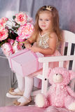 Sweet child girl with pink gift box Stock Images