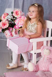 Sweet child girl with pink gift box Royalty Free Stock Photo