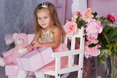 Sweet child girl with pink gift box Royalty Free Stock Image