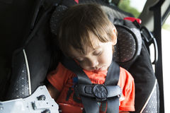 Sweet Child In His Safety Car Seat Royalty Free Stock Images