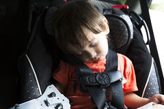 Sweet Child In His Safety Car Seat Royalty Free Stock Photo