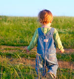 Sweet child in the jeans coverall Royalty Free Stock Images