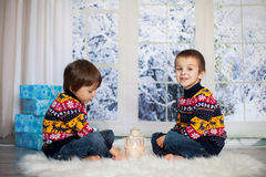 Sweet children, boy brothers,, holding lantern at home on a snow. Y day, wintertime Stock Photos