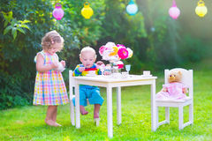 Sweet children at doll tea party Stock Photo