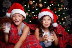 Sweet children drinking milk Royalty Free Stock Photos