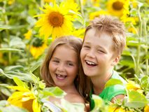 Free Sweet Children In Sunflower Field Royalty Free Stock Image - 23278686