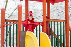 Sweet children, playing in the snow on the playground Stock Photography
