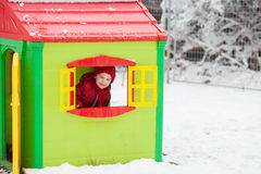 Sweet children, playing in the snow on the playground Stock Photos