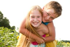 Sweet children in sunflower field Royalty Free Stock Photos
