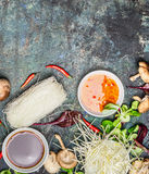 Sweet chili and soy sauces with asian cooking ingredients on dark rustic background, top view Royalty Free Stock Images
