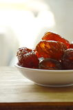 Sweet Chinese jujube on cup Royalty Free Stock Image