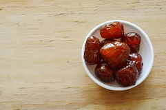 Sweet Chinese jujube on cup Royalty Free Stock Photo