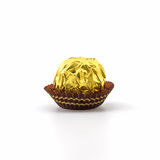 Sweet chocolate ball wrapped in golden foil Royalty Free Stock Image